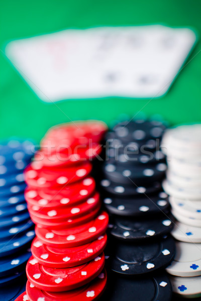 Stock photo: Different chips on the green mat