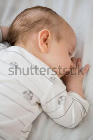 Brunette woman trying to turn off her alarm clock in her bedroom Stock photo © wavebreak_media