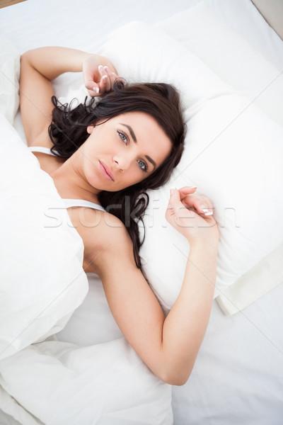 Nő nyújtás karok hálószoba kezek ágy Stock fotó © wavebreak_media
