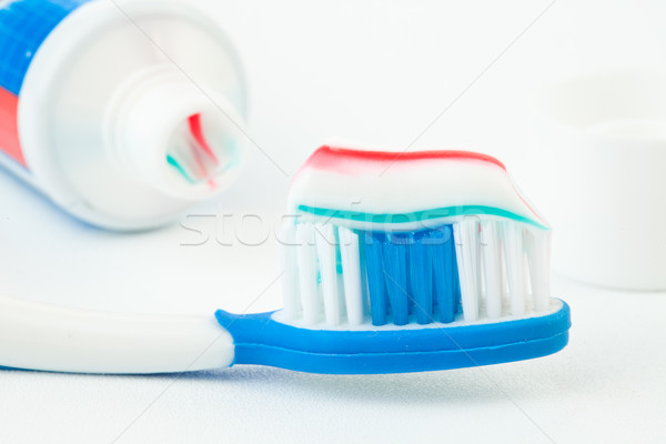 Tube dentifrice brosse à dents blanche bleu rouge Photo stock © wavebreak_media