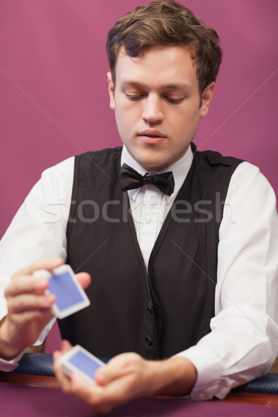 Dealer in casino shiffling cards for poker Stock photo © wavebreak_media