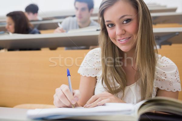 Kadın oturma ders salon yazı gülümseyen kadın Stok fotoğraf © wavebreak_media