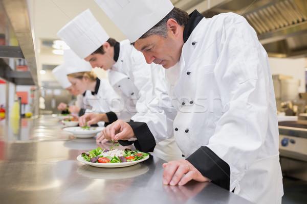 Chef's preparing their salads in the kitchen Stock photo © wavebreak_media