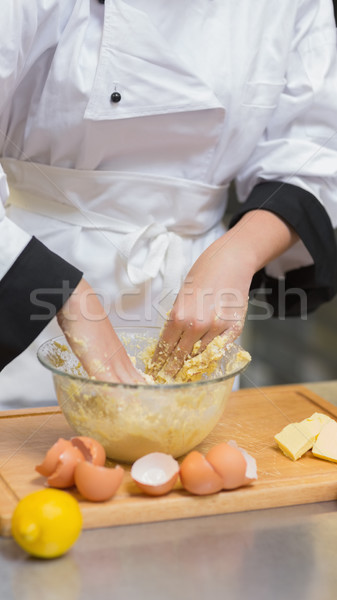 Pastry chef mixing dough with hands Stock photo © wavebreak_media