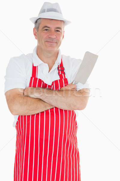 Smiling butcher with crossed arms holding meat cleaver Stock photo © wavebreak_media