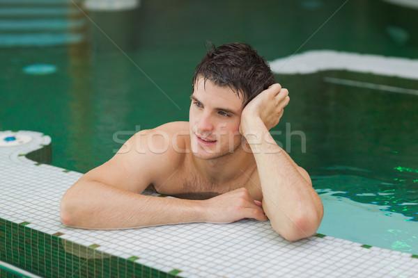 笑みを浮かべて 男 リラックス プール 水 ストックフォト © wavebreak_media