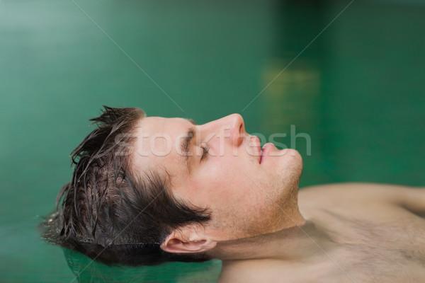 Jóképű férfi lebeg medence úszómedence víz sport Stock fotó © wavebreak_media