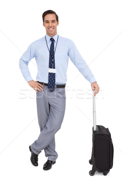 Handsome businessman standing with his suitcase Stock photo © wavebreak_media