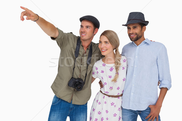 Photographer pointing to something with friends Stock photo © wavebreak_media