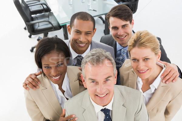 Zárt üzleti csapat mosolyog felfelé kamera iroda Stock fotó © wavebreak_media