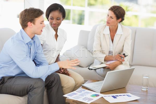 üzleti csapat megbeszélés számok kanapé iroda laptop Stock fotó © wavebreak_media
