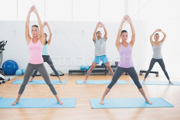 Sporty class doing pilate exercises in fitness studio Stock photo © wavebreak_media
