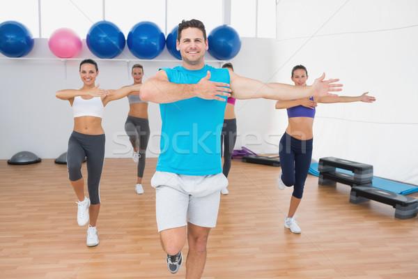 Smiling people doing power fitness exercise in fitness studio Stock photo © wavebreak_media