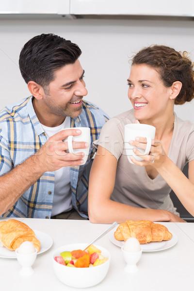 Atraente casal sessão café da manhã juntos casa Foto stock © wavebreak_media