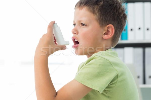 Boy using an asthma inhaler Stock photo © wavebreak_media