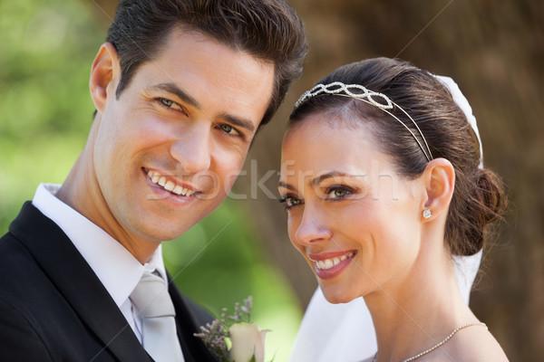 Boldog friss házas pár másfelé néz park közelkép Stock fotó © wavebreak_media