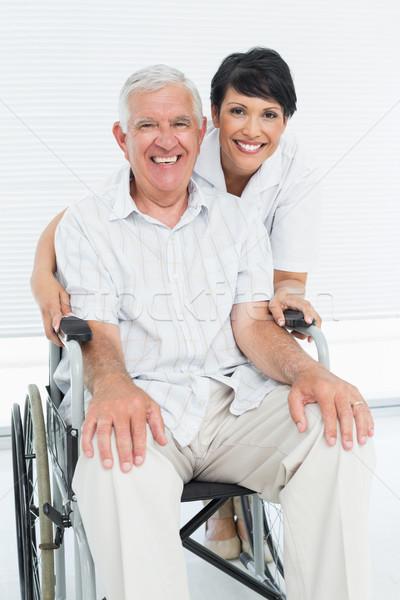 Portrait of a nurse with senior patient sitting in wheelchair Stock photo © wavebreak_media