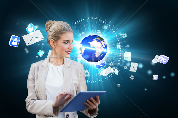 Blonde businesswoman using tablet pc with earth and emails Stock photo © wavebreak_media