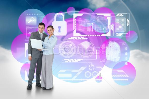 Feliz equipo de negocios usando la computadora portátil seguridad interfaz compuesto digital Foto stock © wavebreak_media