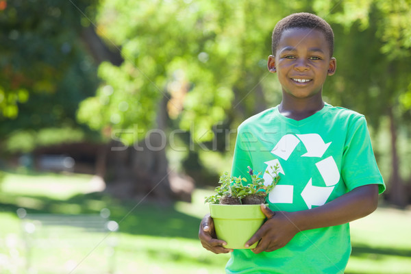 Young boy in recycling tshirt holding potted plant Stock photo © wavebreak_media