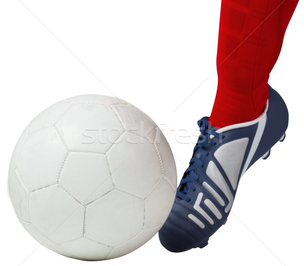 Football player kicking ball with boot Stock photo © wavebreak_media