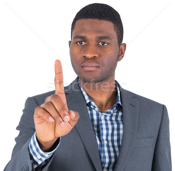 Centrado empresario senalando blanco dedo masculina Foto stock © wavebreak_media