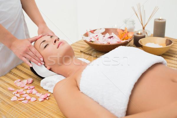 Peaceful brunette enjoying a head massage Stock photo © wavebreak_media