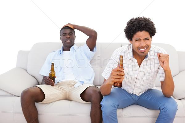Nerwowy sportowe fanów posiedzenia kanapie sportu Zdjęcia stock © wavebreak_media