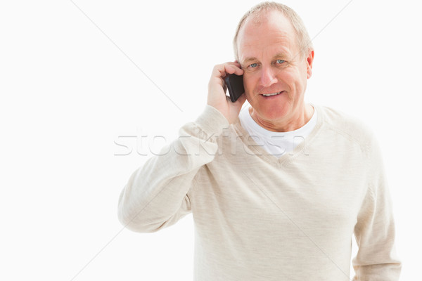 Mutlu olgun adam telefon beyaz kot gülen Stok fotoğraf © wavebreak_media