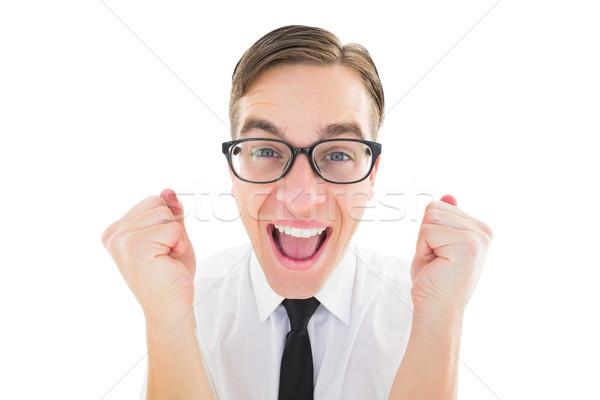 Geeky young hipster cheering at camera Stock photo © wavebreak_media