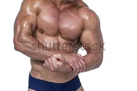 Középső rész póló nélkül izmos férfi áll fehér Stock fotó © wavebreak_media