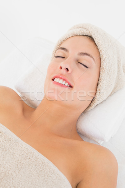 Stock photo: Close up of a beautiful young woman on massage table