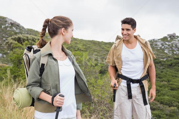 Couple marche montagne terrain portrait randonnée Photo stock © wavebreak_media
