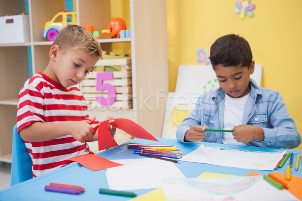 Cute little boys drawing at desk Stock photo © wavebreak_media