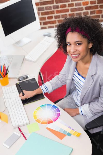 Female photo editor using digitizer in office Stock photo © wavebreak_media