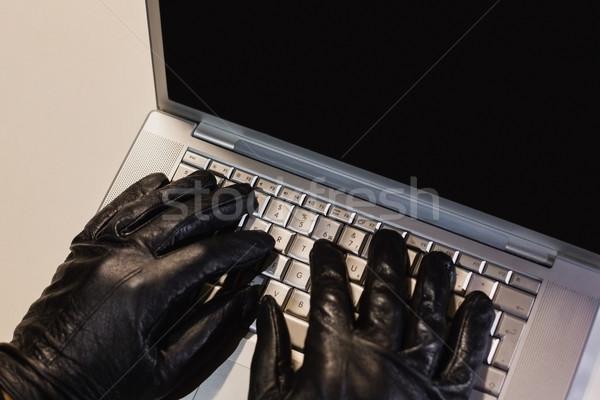 Scassinatore l'hacking laptop nero computer Foto d'archivio © wavebreak_media