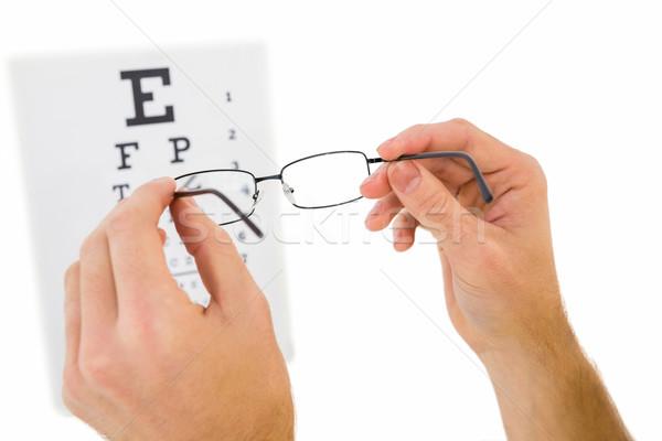 Szemüveg felfelé olvas látásvizsgálat fehér kezek Stock fotó © wavebreak_media