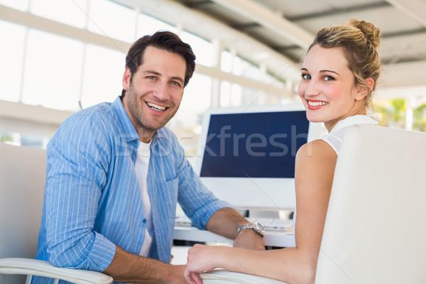 Foto sorridente câmera escritório homem teclado Foto stock © wavebreak_media