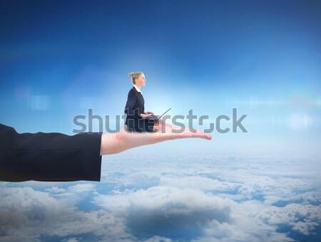 Businessman in suit sitting in lotus pose Stock photo © wavebreak_media