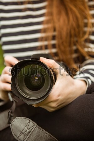 Mid section of female photographer Stock photo © wavebreak_media