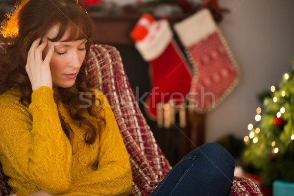 Unhappy redhead getting a headache at christmas Stock photo © wavebreak_media