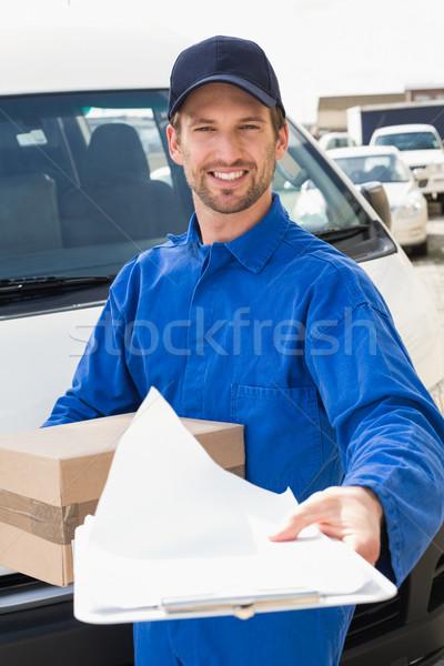 Futár mutat vágólap felirat vásárló kívül Stock fotó © wavebreak_media