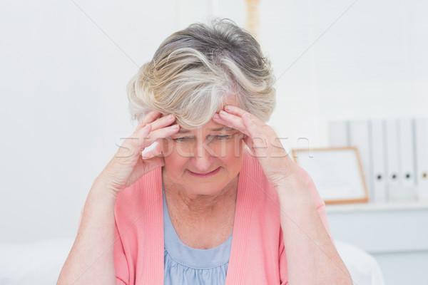 Tensed senior patient suffering from headache Stock photo © wavebreak_media