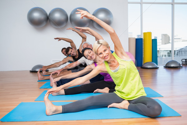 People exercising on mats in fitness club Stock photo © wavebreak_media