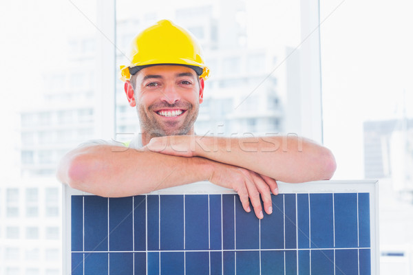 Smiling manual worker with solar panel in office Stock photo © wavebreak_media