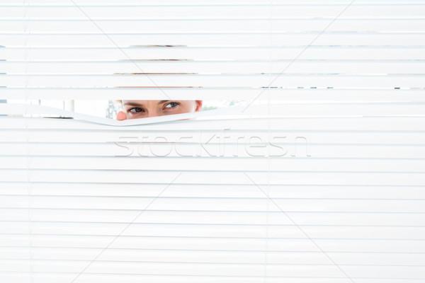 любопытный глядя жалюзи женщину Сток-фото © wavebreak_media