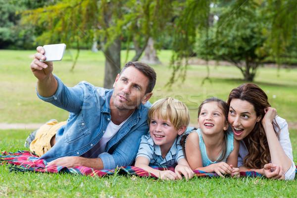 Happy family in the park taking selfie Stock photo © wavebreak_media