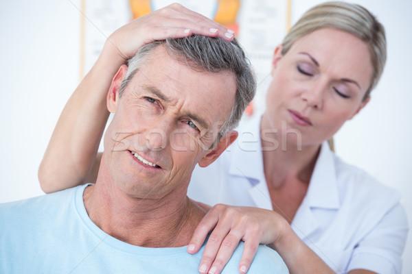 Arts patiënt nek medische kantoor Stockfoto © wavebreak_media