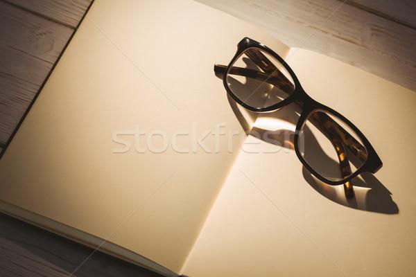 Empty notepad with reading glasses Stock photo © wavebreak_media