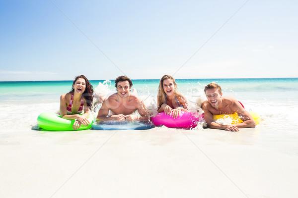 Felice amici gonfiabile materasso sopra acqua Foto d'archivio © wavebreak_media